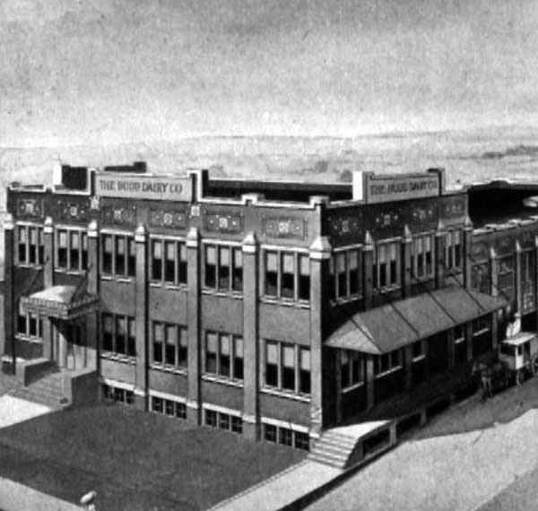 Historical black and white photo of the Budd Dairy exterior.