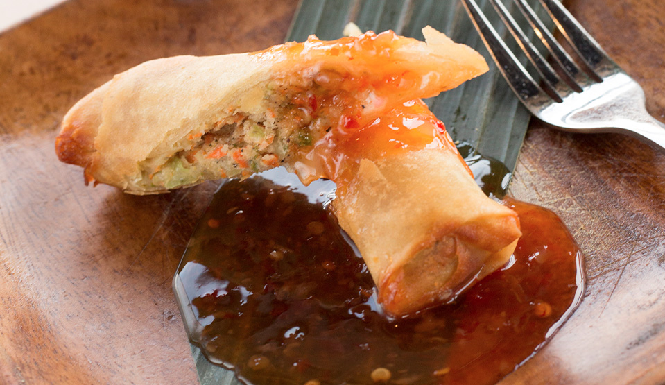 egg roll with sauce garnish