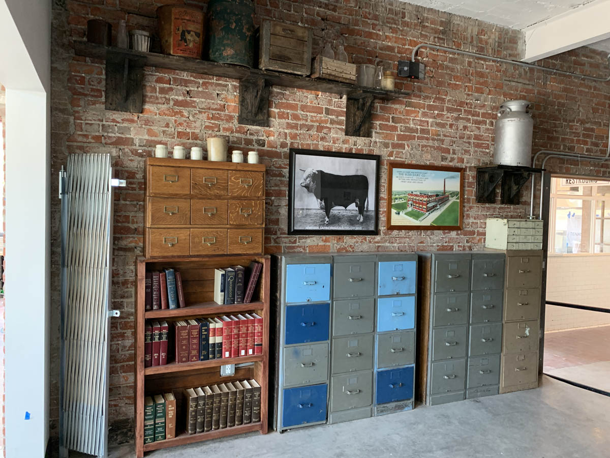 Interior decorative detail of Budd Dairy Food Hall. Filing cabinets against a wall and book shelves.
