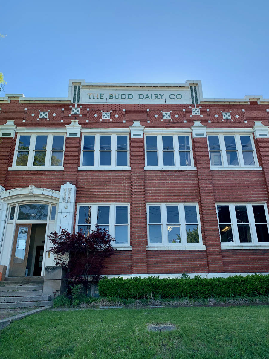 Exterior of Budd Dairy Food Hall during the daytime.