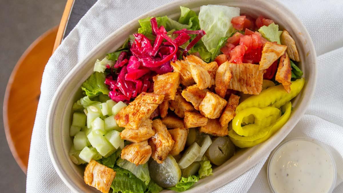 Mediterranean salad topped with chicken gyro