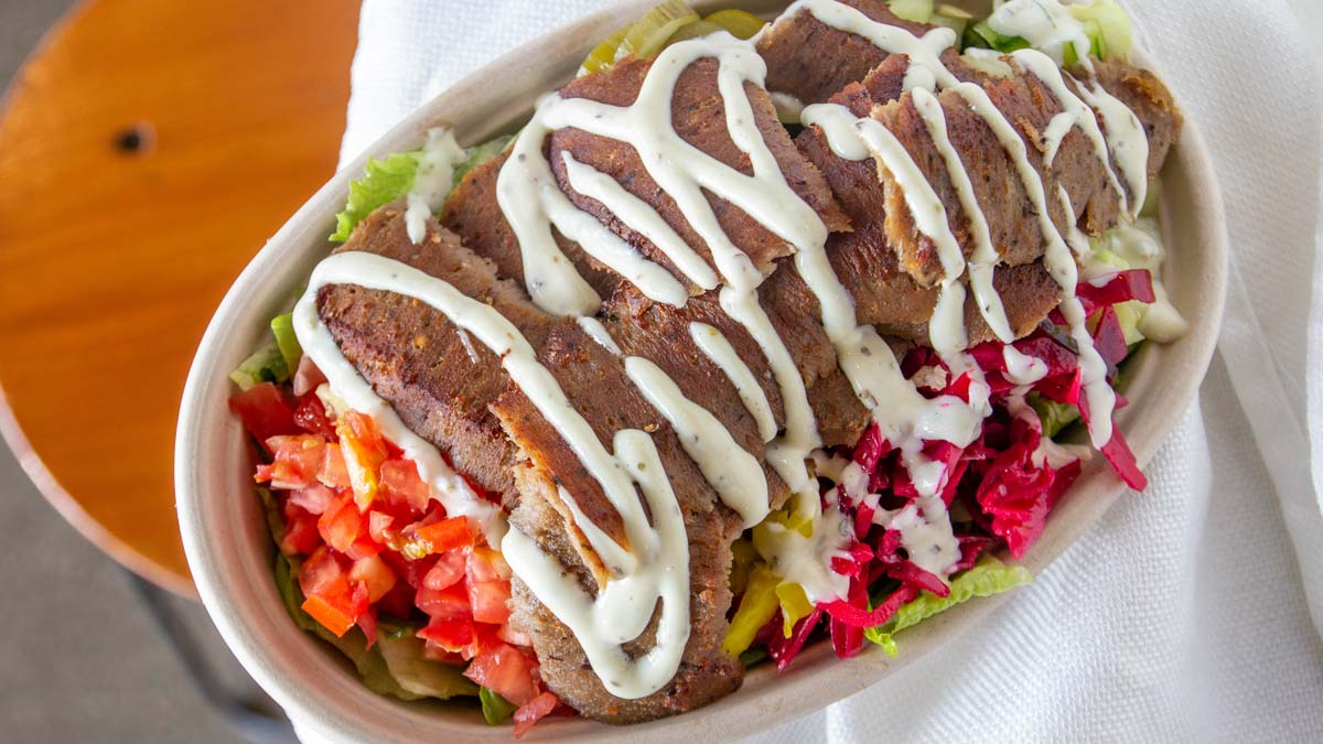 Mediterranean salad topped with gyro meat