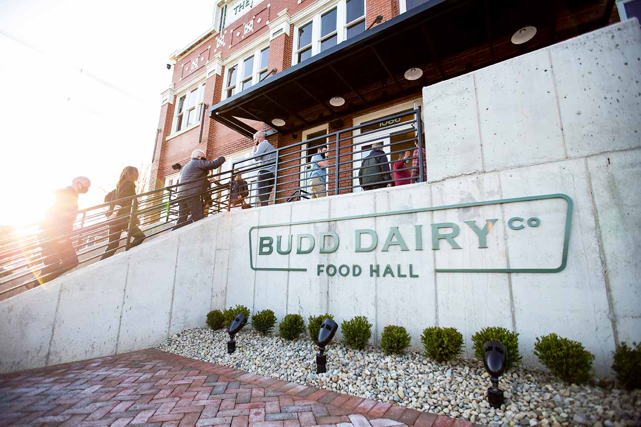 people entering main doors at Budd Dairy Food Hall.