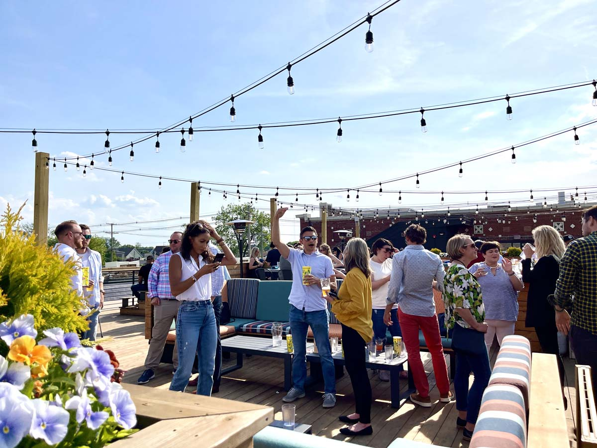 People enjoying a sunny afternoon on the Budd Dairy Food Hall rooftop.