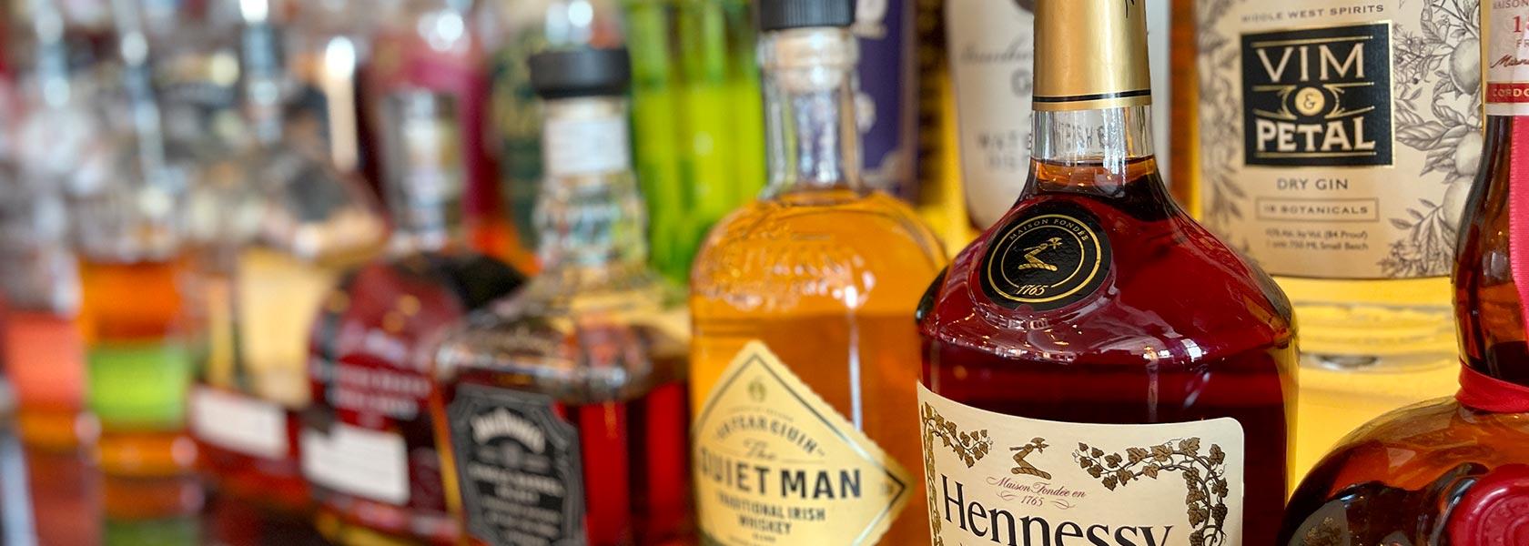 Bottles of spirits on bar.