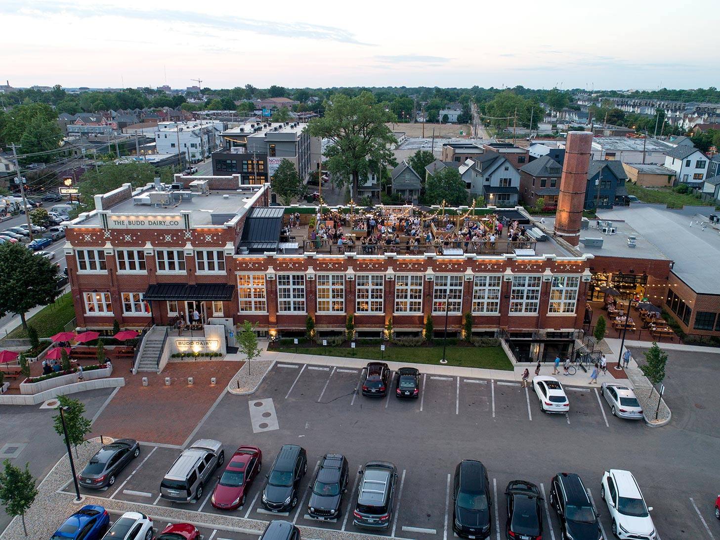 Aerial view of Budd Dairy Food Hall showing main entrance, parking lot and rooftop activity.