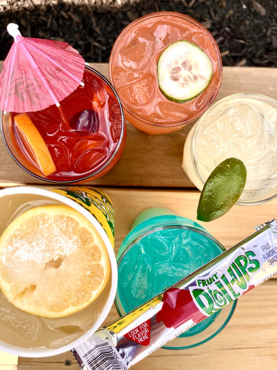 Overhead view of colorful cocktails with garnishes