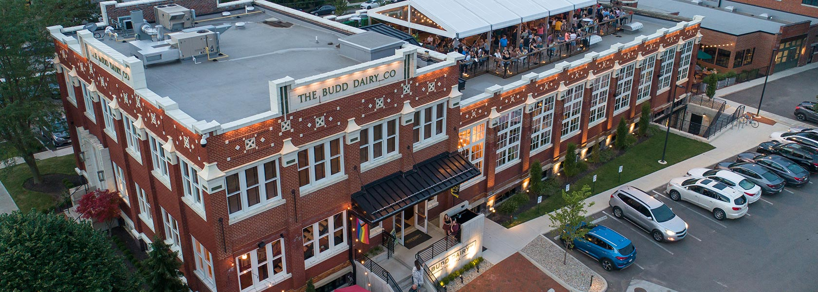 Aerial view of Budd Dairy Food Hall with rooftop gathering.