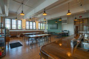 Long tables and seating inside Simon's Bar at Budd Dairy Food Hall