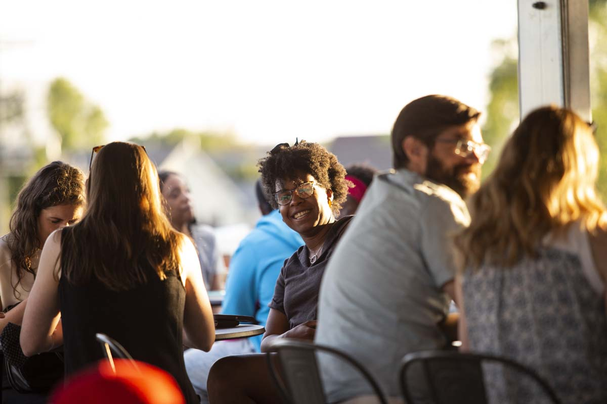 People socializing in an outdoor bar setting