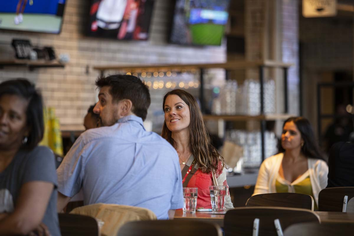 People socializing in an indoor bar setting